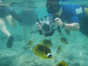 Bart Hunt Filming Fish at Kahalu'u Beach: Photo By Donnie MacGowan