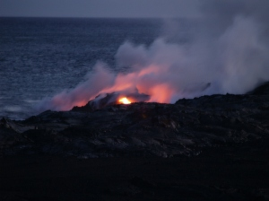 Lava enters the sea Waikupanaha, Big Island:Photo by Donald MacGowan
