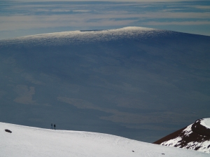 Hikers on the summit of Mauna Kea looking toward Mauna Loa: Photo by Donnie MacGowan