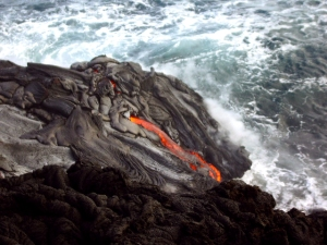 Lava enters the sea at La'eapukii, Hawaii Volcanoes National Park: Photo by Donald MacGowan