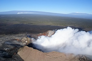 Sulfur dioxide emissions from the Pu`u `Ō `ō vent on Kilauea's east rift (right foreground), and the summit vent in Halema`uma`u Crater (in front of Mauna Loa, left background), were being blown to the northeast by winter winds in this January 14, 2009, USGS photo.