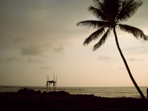 Sunset over the Ancient Surfing Temple of Ku'emanu Heiau, Kona Hawaii: Photo by Donald MacGowan