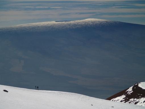 Hikers on Mauna Kea Summit Looking at Mauna Loa Summit: Photo by Donnie MacGowan