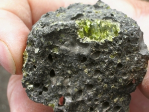 Olivine Phenocrysts in Vesicular Basalt Near Ke-awa-iki: Photo by Donald MacGowan