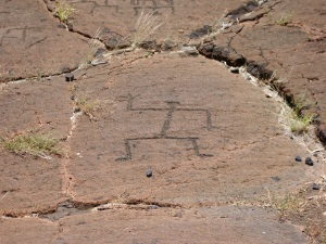 "A Standing Figure from Puako Petroglyph Field; Many Authorities Believe the Raised Right Hand Signifies the Hawaiian Primary Geographic Direction We Call ""North-west"": Photo by Donnie MacGowan"