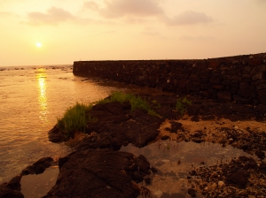 Vog Tinged Sunset around Winter Solstice at the Reconstructed Hapaiali'i Heiau: Photo by Donald B. MacGowan