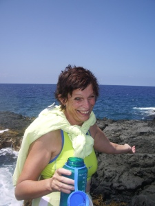 Lora Aller Hydrates on a Kona Coast Hike; Taking a Small Pack Helps Keep Water Bottles, Sunscreen, Sunglasses, Camera and Other Necessities Handy and Easy to Carry: Photo by Donald MacGowan