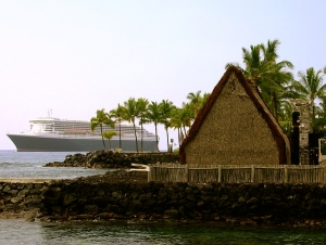 Juxtaposition of Two Cultures; the Newest Queen Mary at Anchor in Kailua Bay, Behind Ancient Ahu'ena Heiau: Photo by Donald B. MacGowan
