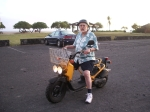 Bradford MacGowan Rips Around Kona on a Scooter--Which Are Locally Known As Mopeds: Photo by Donald B. MacGowan