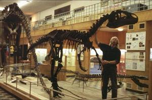 Brent Breithaupt, the World Renowned and Beloved Curator of the UW Geological Museum Has a Private Word with the Allosaurus (photo from: http://www.wyomingtourism.org/stream/28740?)