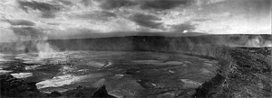 A view of the lava lake within Halema`uma`u Crater on December 27, 1911, with Uwekahuna bluff (where HVO and the Jaggar Museum now stand) and Mauna Loa in the background. The lake level had risen about 120 m (400 ft) since October 1911 and will drop 90 m (300 ft) in January, 1912, the month that HVO was founded by Thomas A. Jaggar's arrival for duty.