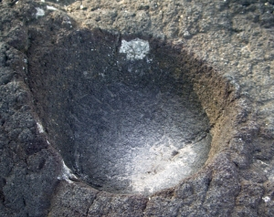 Small Bowl Carved into Surface of Basalt, Pu'u Honua O Honaunau National Historic Park, Hawaii: Photo by Donnie MacGowan
