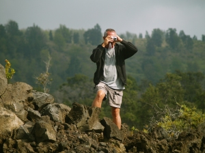 Frank Burgess stops to take a photo while hiking the Ka'u Desert Trail: Photo by Donald B. MacGowan