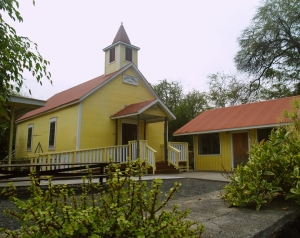 The Hike to Honomalino Beach Starts between the County Park Restrooms and this Yellow Church: Photo by Donald MacGowan