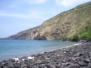 Looking from Hikiau Heiau to Cook Monument; the Cliffs and Boulders Make Hiking Along the Shoreline to the Monument Both Difficult and Extremely Dangerous--DO NOT ATTEMPT THIS: Photo by Donnie MacGowan
