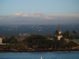 Hualalai Looms over the sleepy fishing village of Kailua Kona, protected by it's seawall, Hawaii Photo by Donnie MacGowan