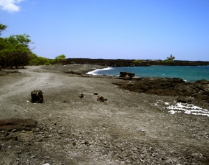 The road south from Kiholo Bay dead ends at an elaborate mansion; from there a trail can be taken around the headland to a remarkable black sand cove that provide gorgeous, if exposed, snorkeling: Photo by Donald B. MacGowan