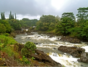 During wet weather, Rainbow Falls becomes a thunderous cascade, Hilo Hawaii Photo by Donald B. MacGowan