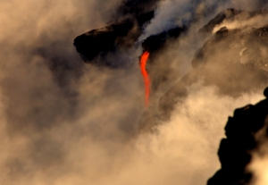 Lava from Kilauea Volcano flows into the ocean near Kalapana, Hawaii: Photograph by Donald B. MacGowan