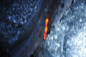 The same dim lava in the dark: note the glow indicating the presence of dangerous, liquid lava mere inches below the ground surface: Photo by Donald B MacGowan