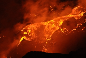 A large lava stream flows over a falls, Kalapana Hawaii August 2010: Photo by Donald B MacGowan