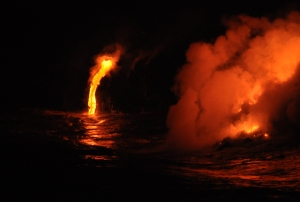 A Lava Ribbon Flows Into the Ocean, Near Kalapana, Hawaii: Photo by Donnie MacGowan